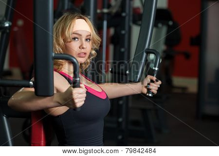 Girl Works Out In Gym On A Butterfly Machine