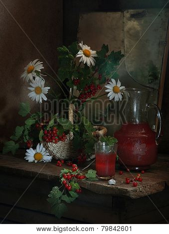 Berry Juice From A Red Currant In A Transparent Jug And A Bouquet From Gentle Camomiles