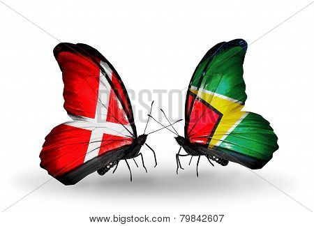 Two Butterflies With Flags On Wings As Symbol Of Relations Denmark And Guyana