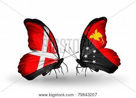 Two Butterflies With Flags On Wings As Symbol Of Relations Denmark And Papua New Guinea