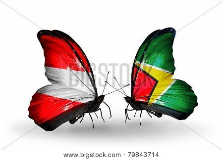 Two Butterflies With Flags On Wings As Symbol Of Relations Austria And Guyana