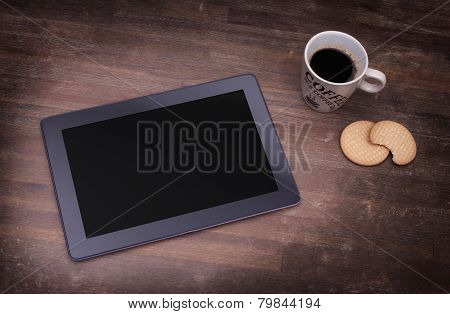 Tablet Touch Computer Gadget On Wooden Table