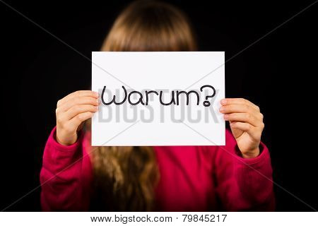 Child Holding Sign With German Word Warum - Why