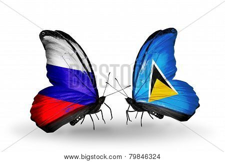 Two Butterflies With Flags On Wings As Symbol Of Relations Russia And Saint Lucia