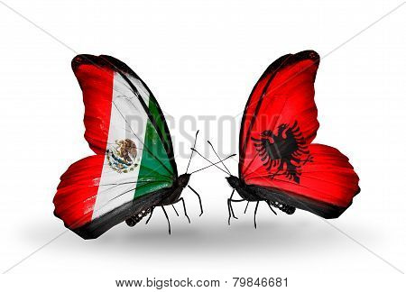Two Butterflies With Flags On Wings As Symbol Of Relations Mexico And Albania