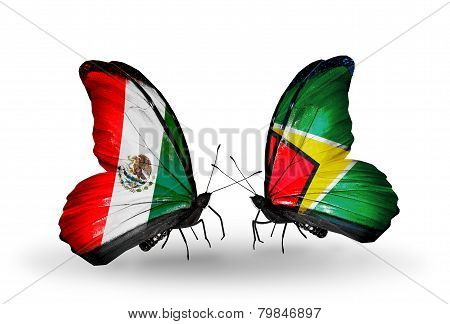 Two Butterflies With Flags On Wings As Symbol Of Relations Mexico And Guyana