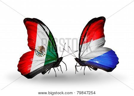 Two Butterflies With Flags On Wings As Symbol Of Relations Mexico And Luxembourg