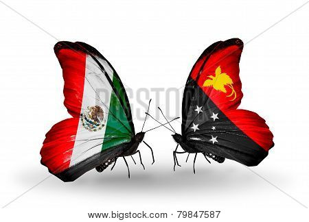 Two Butterflies With Flags On Wings As Symbol Of Relations Mexico And Papua New Guinea