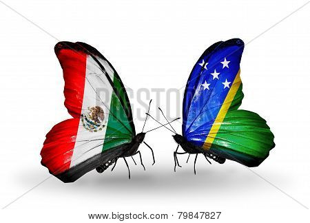Two Butterflies With Flags On Wings As Symbol Of Relations Mexico And Solomon Islands