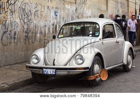 VW Beetle with Wheel Clamps in La Paz, Bolivia
