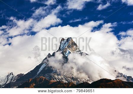 Peak Machapuchare over clouds, Nepal