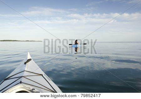 Woman Kayaks On Lake Ontario