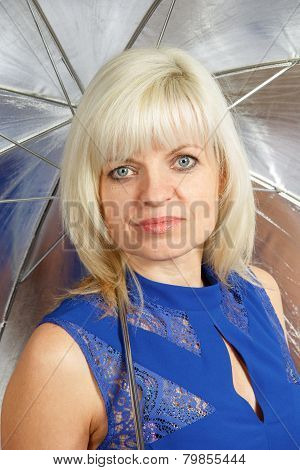 A blonde with an umbrella