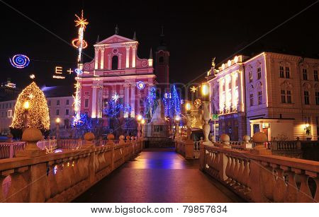St. Francis church and Preseren square, decorated for Christmas and New Year's holidays, Ljubljana,