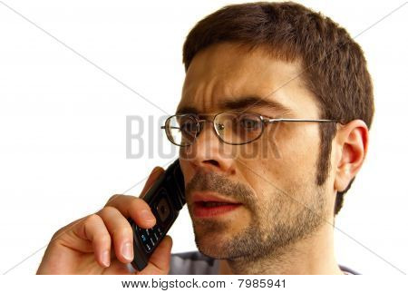 Perplexed Man Talking By Phone