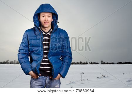 Asian man in blue down-padded coat winter outdors
