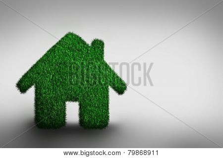 Green, eco friendly house concept. Grassy building on gray. Real estate, architecture and environment.