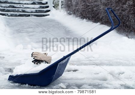 Big Snow Shovel Full Of Heavy Icy Snow In Front Of House Entrance