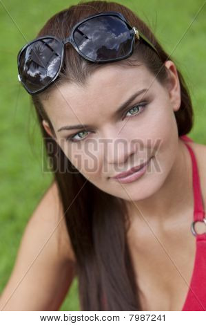 Outdoor Natural Light Portrait Of Beautiful Woman With Green Eyes