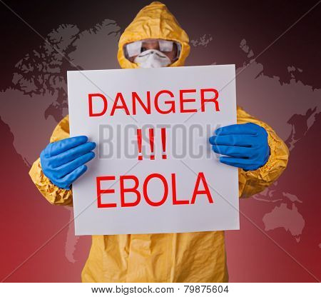 Scientist with protective yellow hazmat suit, ebola concept.
