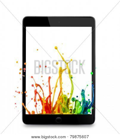 Tablet on white background with colo liquid splash.
