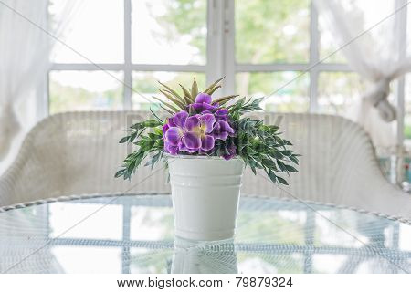 Flower In Vase On Table And Window Sill Background. Vintage Style Decorate
