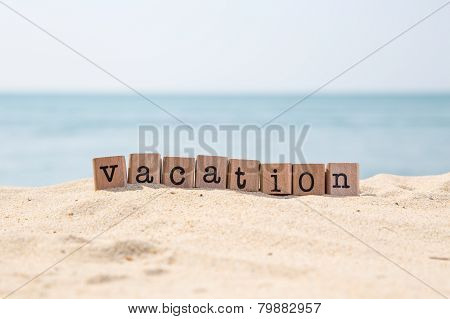 Vacation Word On Sunny Beach With Ocean Background