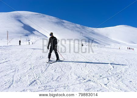 Skier Skiing On The Mountain Of Falakro, Greece. The Ski Resort Of Falakro Mountain Is Located In Th
