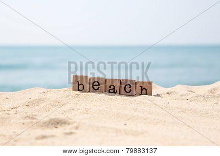 Beach Word On Seaside With Blue Ocean Background
