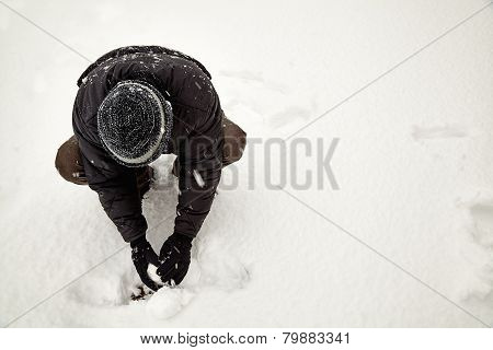 Young Adult Making Snow Ball
