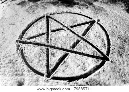 Pentagram written in dust
