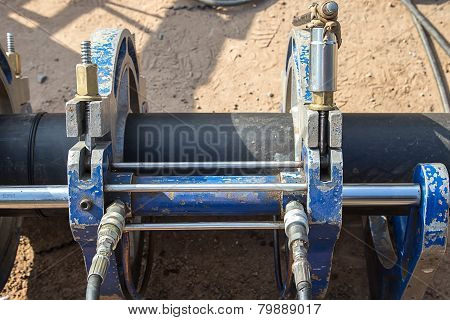 The Mechanic Works At A Welding Machine For Connection Of Plastic Pipes
