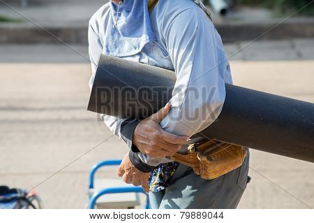 Man Holding Plumbing For Connection Of Plastic Pipes