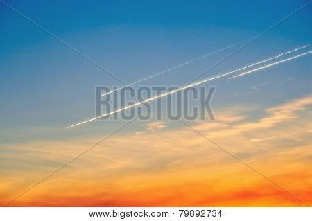 traces of plane in evening sky. cloudscape