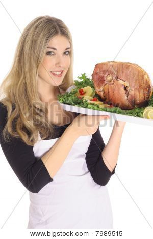gorgeous woman serving a ham