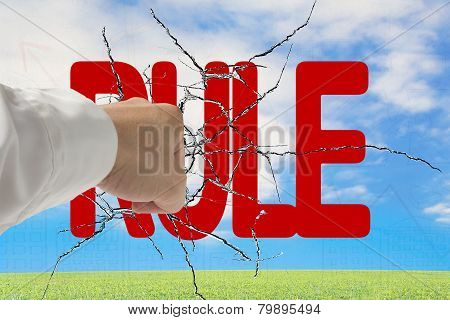 Man Hand Hitting Red Rule Word On Cracked Transparent Glass