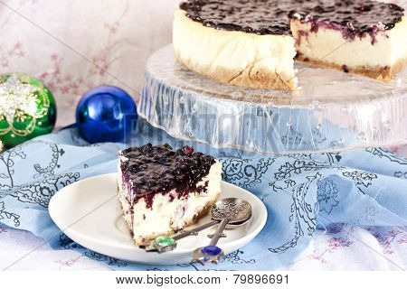 cheesecake with mascarpone and blueberry sauce