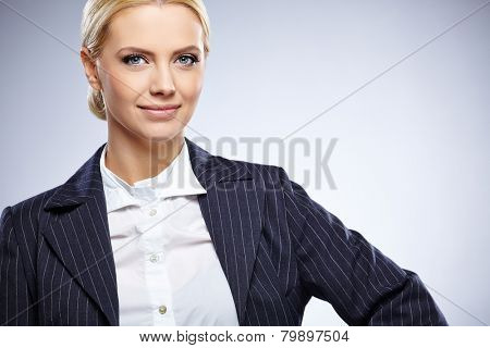 Portrait of a beautiful young business woman standing against blue  background