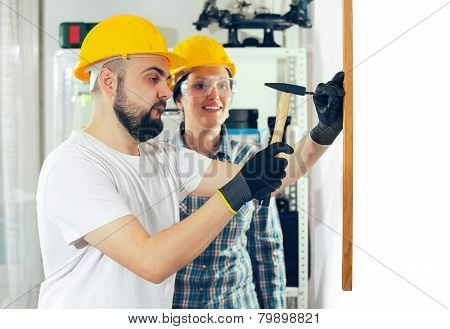 Craftsman and craftswoman posing together, selective focus