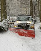 foto of slippery-roads  - Truck with snowplow on road after snowstorm  - JPG