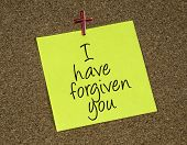 stock photo of forgiven  - a reminder note with a statement that Jesus forgives - JPG