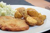 pic of wieners  - Wiener schnitzel with fried potato wedges and cabbage salad.