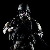 pic of assault-rifle  - United States Army ranger with assault rifle on dark background - JPG