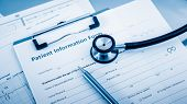 pic of endocrine  - Stethoscope on patient form on the desk - JPG