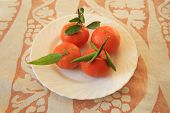 image of florida-orange  - Freshly picked ripe oranges on a plate - JPG