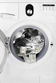 stock photo of washing-machine  - Money in washing machine - JPG