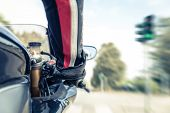 picture of acceleration  - man accelerating at the green light with motorcycle - JPG