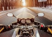 pic of slippery-roads  - Biker rides on winter slippery road - JPG