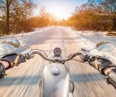 image of slippery-roads  - Biker rides on winter slippery road - JPG
