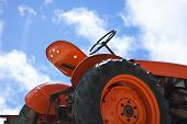 foto of tractor  - red tractor with blue sky in the background - JPG